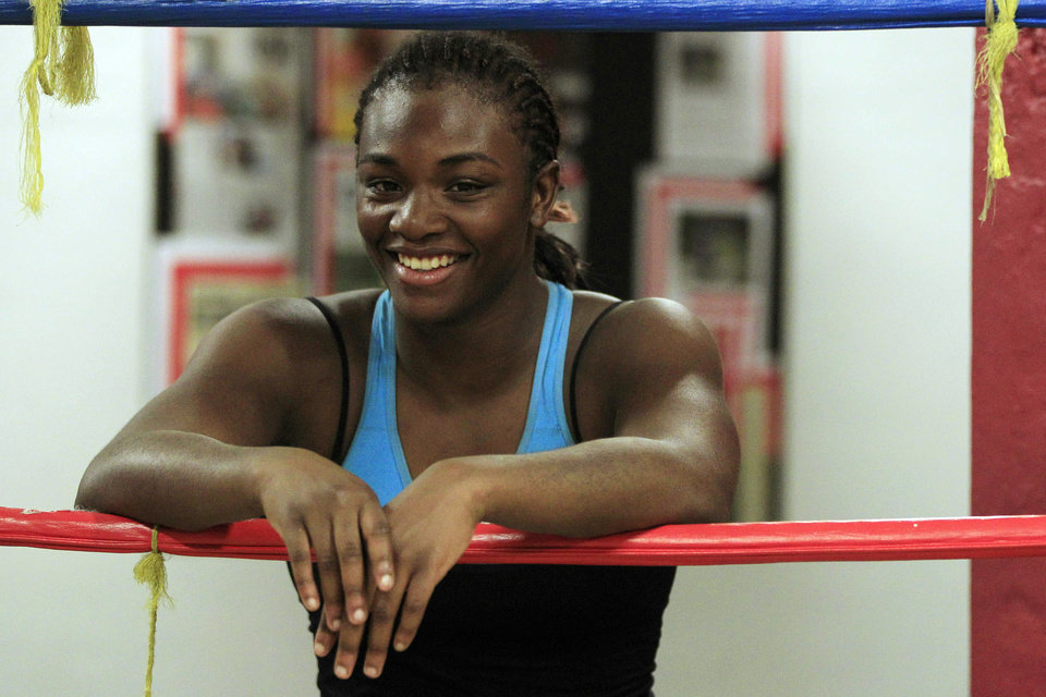 Photo -   In this Sept. 18, 2012, photo, Olympic gold medal boxer Claressa Shields takes a break during workouts at the Berston Field House in Flint, Mich. The ferociousness that won Shields an Olympic gold medal melted away as she climbed on the podium to claim it. (AP Photo/Carlos Osorio)