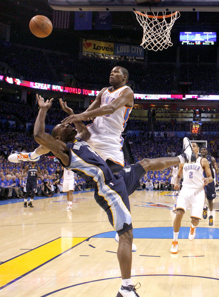 Photo - Oklahoma City's Kevin Durant (35) fouls Tony Allen (9) of Memphis during game 7 of the NBA basketball Western Conference semifinals between the Memphis Grizzlies and the Oklahoma City Thunder at the OKC Arena in Oklahoma City, Sunday, May 15, 2011. Photo by Sarah Phipps, The Oklahoman