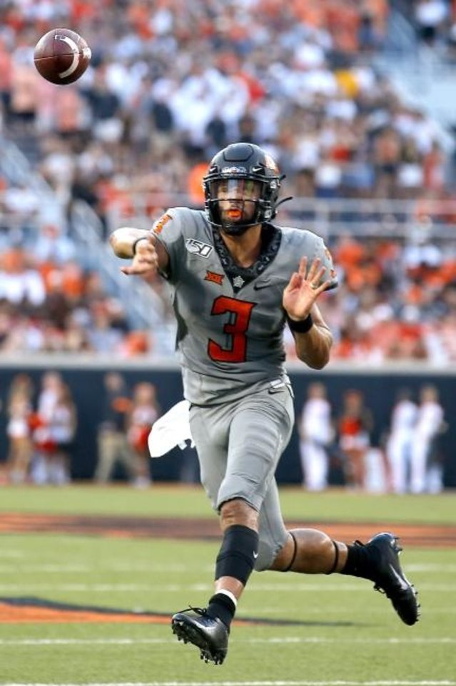 Photo -  Oklahoma State's Spencer Sanders (3) throws a touchdown pass to Tylan Wallace (2) in the second quarter during the college football game between the Oklahoma State Cowboys and the McNeese State Cowboys at Boone Pickens Stadium in Stillwater, Okla., Saturday, Sept. 7, 2019. [Sarah Phipps/The Oklahoman]