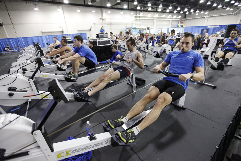 Photo - Teams compete in rowing events during Bart & Nadia's Sports & Health Festival at the Cox Convention Center in Oklahoma City, OK, Saturday, February 16, 2013,  By Paul Hellstern, The Oklahoman