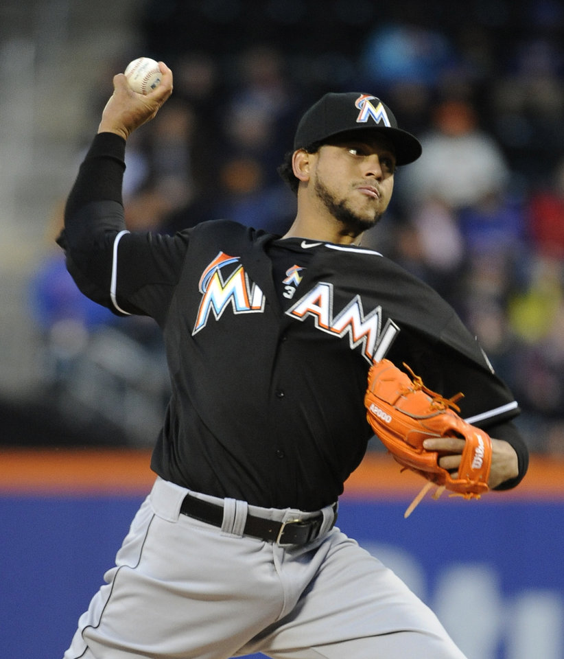 Photo - Miami Marlins starting pitcher Henderson Alvarez throws against the New York Mets in the first inning of a baseball game Friday, April 25, 2014, in New York. (AP Photo/Kathy Kmonicek)