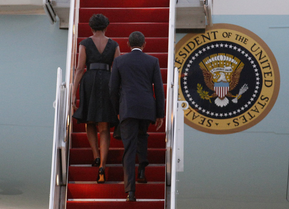 Photo -   President Barack Obama and first lady Michelle Obama board Air Force One before their departure from Andrews Air Force Base, Sunday, Sept, 11, 2011. Ten years after 9/11 terror attacks, Barack Obama and first lady Michelle Obama are traveling to New York and and Shanksville, Penn., to attend memorial services and then to the Pentagon later in the day.(AP Photo/Jose Luis Magana)