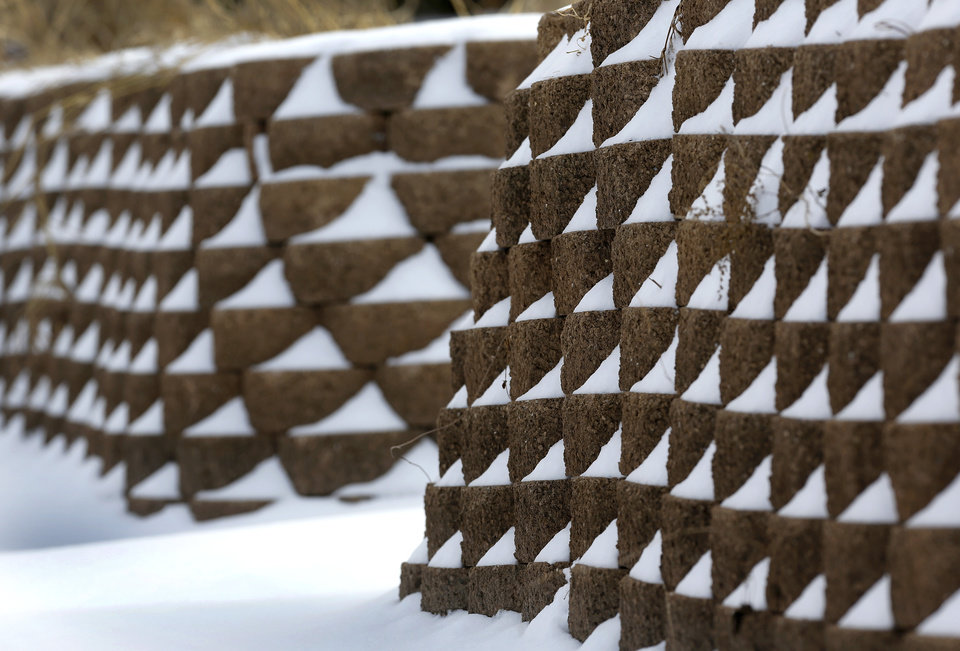 Photo - Snow on landscaping bricks in Kiwanis Park in Midwest City on Friday, Dec. 6, 2013. Photo by Jim Beckel, The Oklahoman