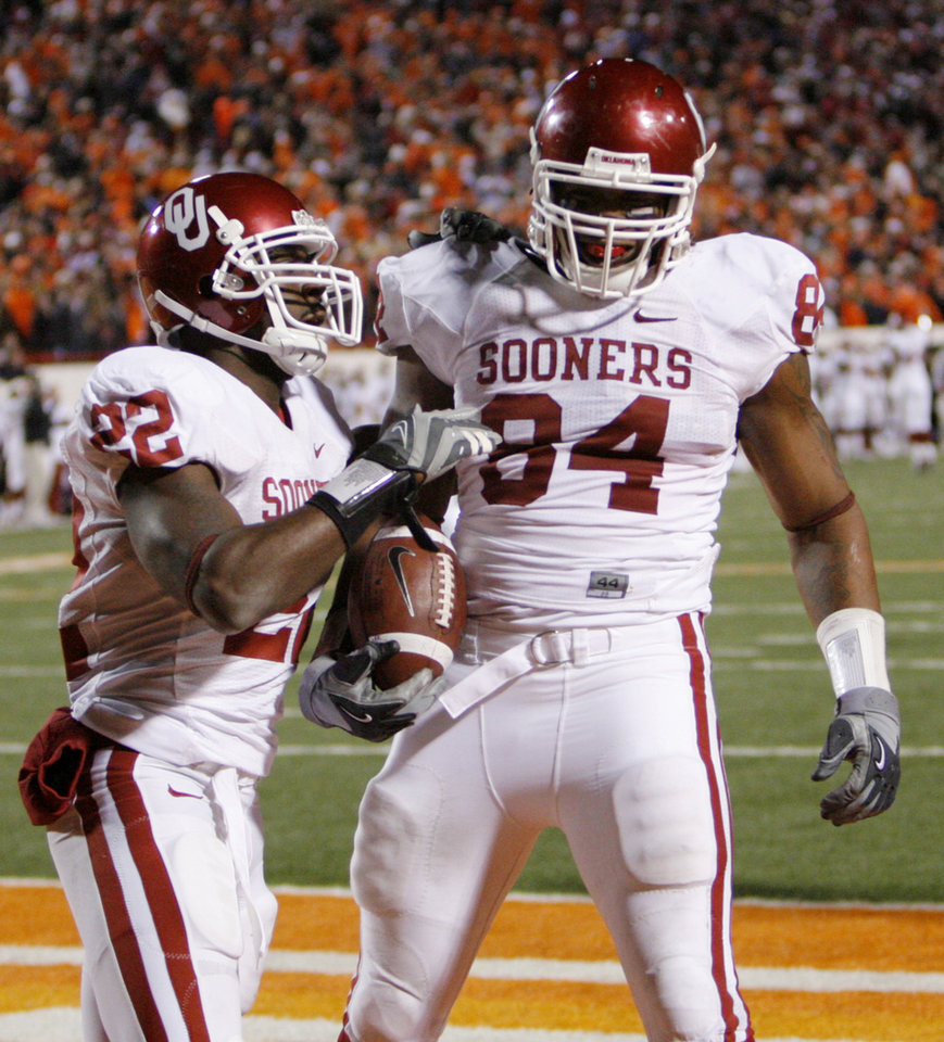 Keenan Clayton (22) celebrates with Frank Alexander (84) after Alexander's fumble return during the second half of the college football game between the University of Oklahoma Sooners (OU) and Oklahoma State University Cowboys (OSU) at Boone Pickens Stadium on Saturday, Nov. 29, 2008, in Stillwater, Okla. STAFF PHOTO BY CHRIS LANDSBERGER