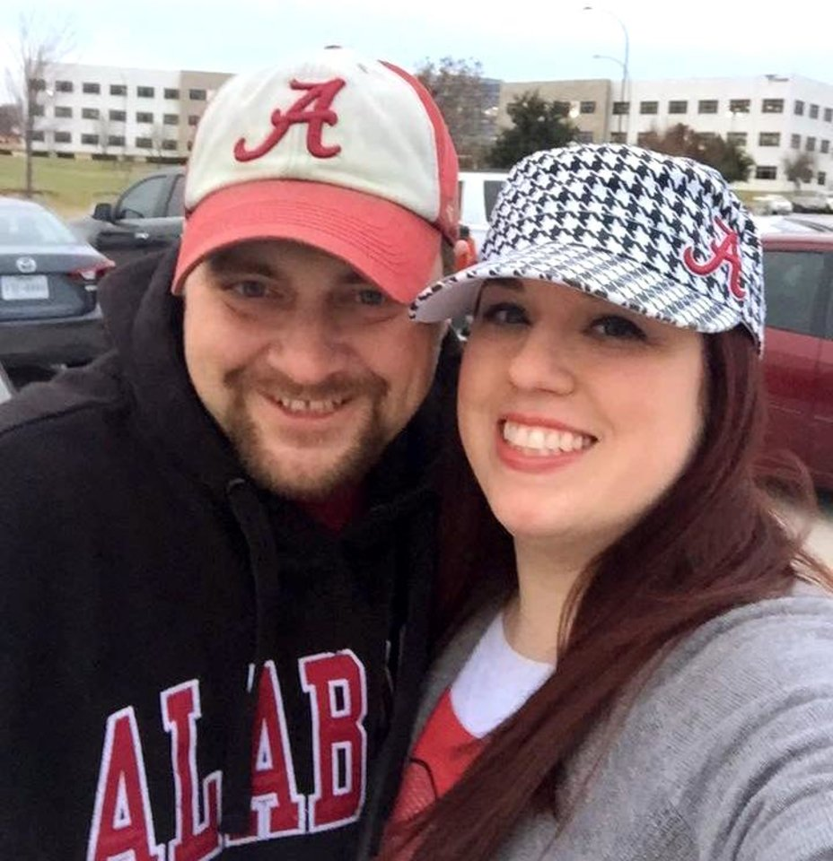 Photo -  Alabama fans and Oklahoma residents Chris and Amee Shaw are always on the lookout for other Crimson Tide faithful. Chris recently circled a Walgreen's parking lot to holler