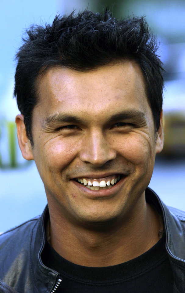 Photo - Actor Adam Beach arrives to the special screening of the Dreamworks animation movie Shrek the Third in New York, Monday, May, 14, 2007. ( AP Photo/Stuart Ramson)  ORG XMIT: NYSR122