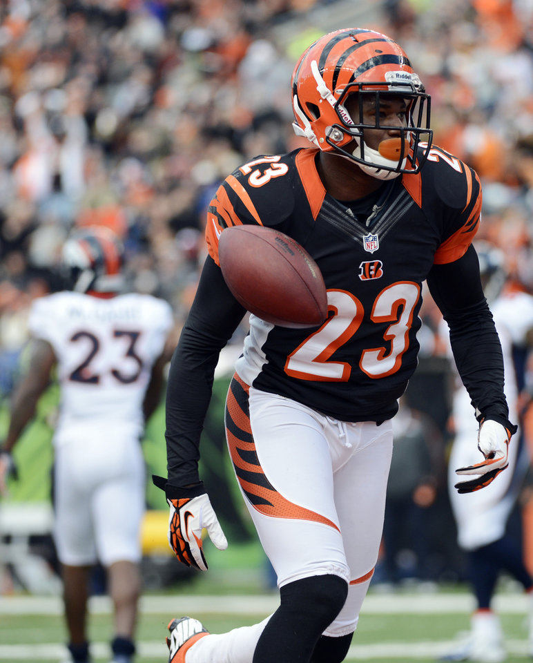 In this Nov. 4, 2012, file photo, Cincinnati Bengals cornerback Terence Newman (23) celebrates after making an interception in the second half of an NFL football game against the Denver Broncos in Cincinnati. Newman was a high draft pick who spent nine mostly productive years with the Dallas Cowboys. (AP Photo/Michael Keating, File)