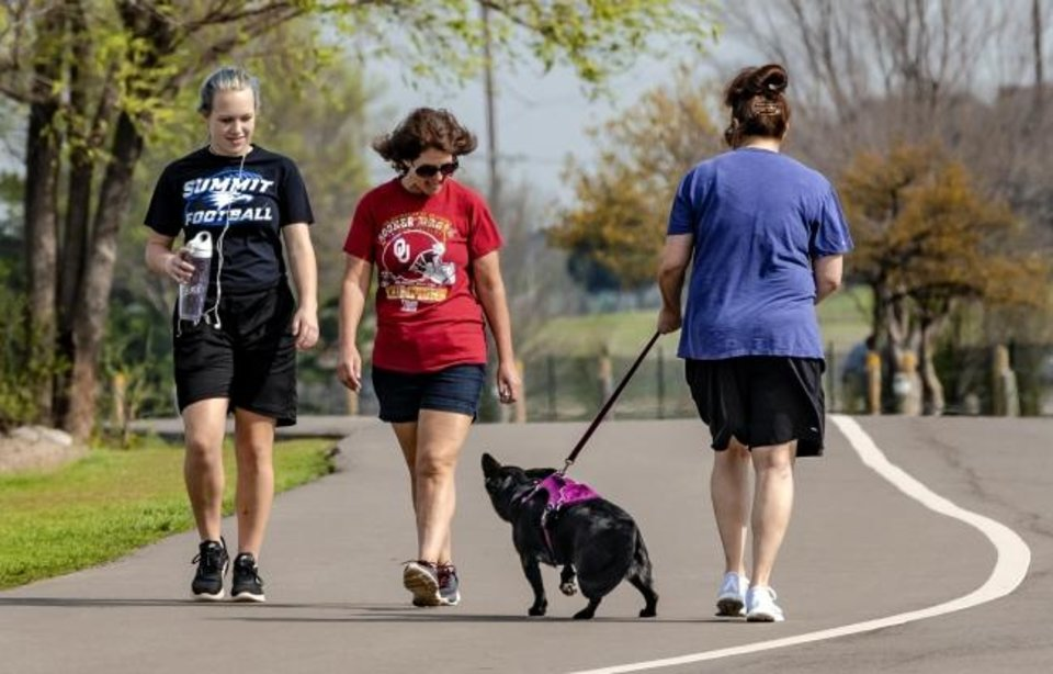 Photo - People walk around Lake Hefner while enjoying the opportunity of nice weather in Oklahoma City, Okla. on Friday, March 27, 2020. [Chris Landsberger/The Oklahoman]