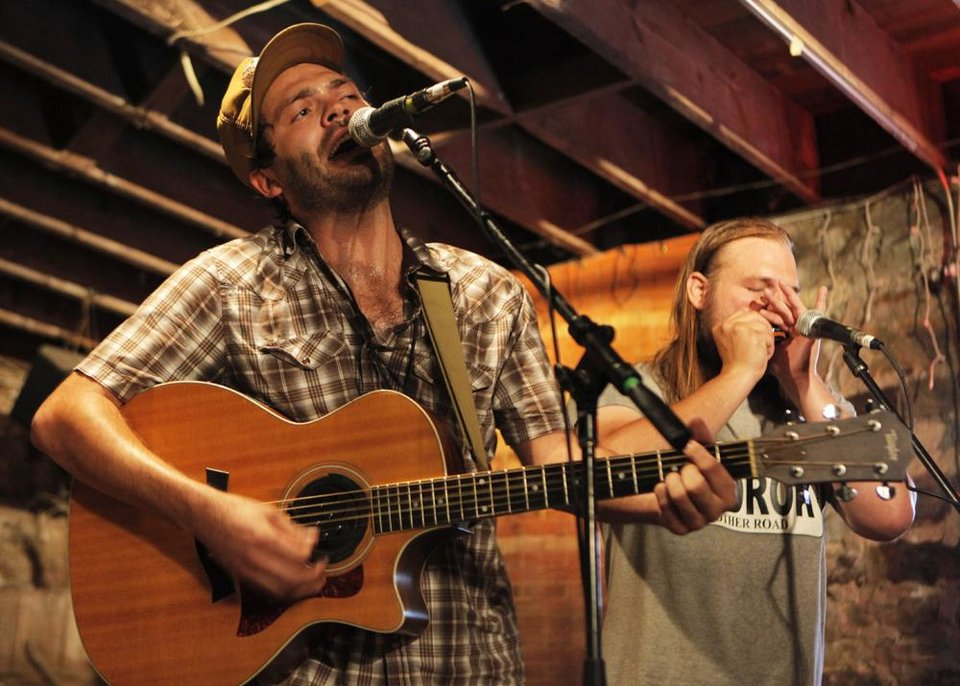 Photo -  The Damn Quails perform during the Woody Guthrie Folk Festival in Okemah, Okla., Thursday, July 12, 2012.  Photo by Garett Fisbeck, The Oklahoman