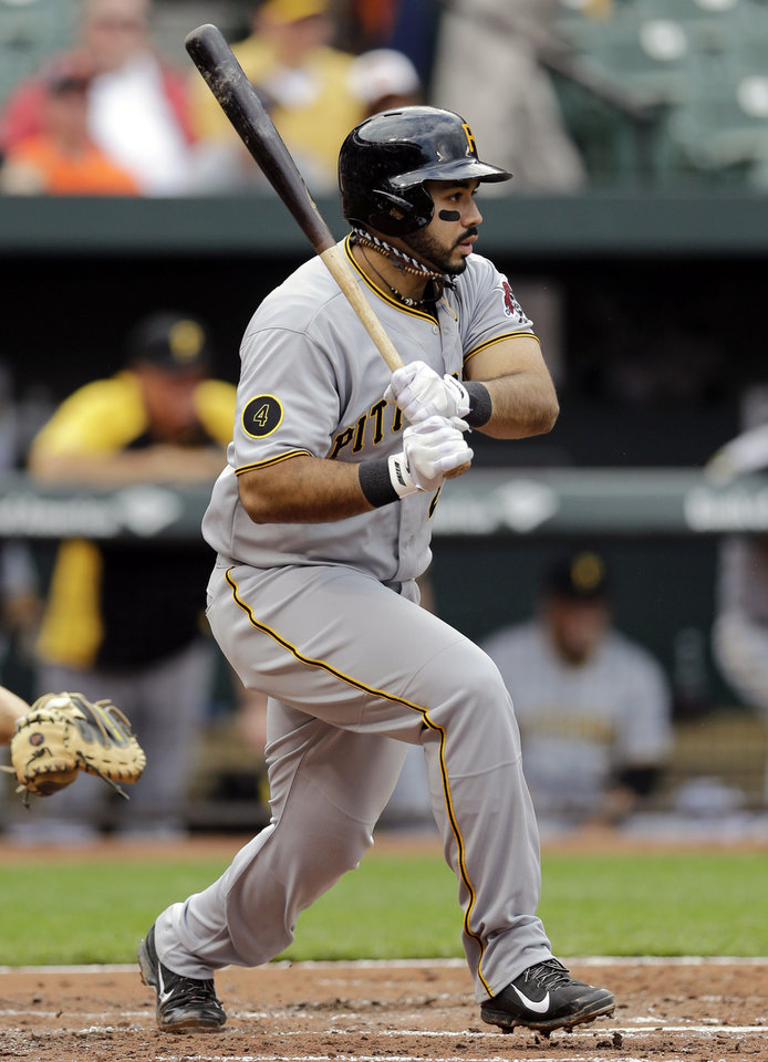 Photo - Pittsburgh Pirates' Pedro Alvarez hits an RBI-single in the third inning of the first baseball game of a doubleheader against the Baltimore Orioles, Thursday, May 1, 2014, in Baltimore. Pirates' Jose Tabata scored on the play. (AP Photo/Patrick Semansky)