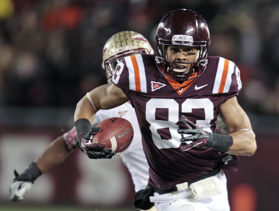 Photo -   Virginia Tech wide receiver Corey Fuller runs in front of a Florida State defender during the first half of an NCAA college football game in Blacksburg, Va., Thursday, Nov. 8, 2012. (AP Photo/Steve Helber)