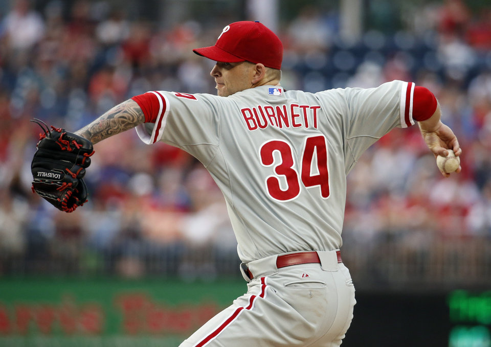 Photo - Philadelphia Phillies starting pitcher A.J. Burnett throws during the first inning of a baseball game against the Washington Nationals at Nationals Park Saturday, Aug. 2, 2014, in Washington. (AP Photo/Alex Brandon)