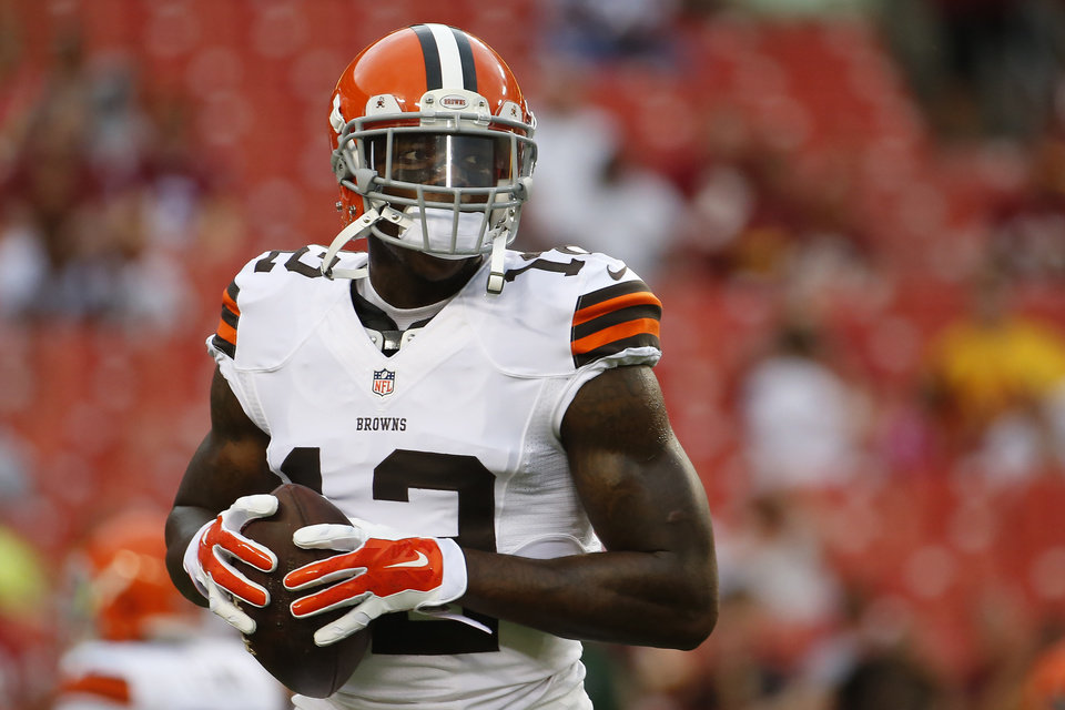 Photo - FILE - In this Aug. 18, 2014, file photo, Cleveland Browns wide receiver Josh Gordon (12) warms up before an NFL preseason football game against the Washington Redskins in Landover, Md. Gordon has been suspended by the NFL one year for violating the league's substance abuse policy. Gordon's suspension is effective immediately and he will miss the entire 2014 season. (AP Photo/Evan Vucci, File)