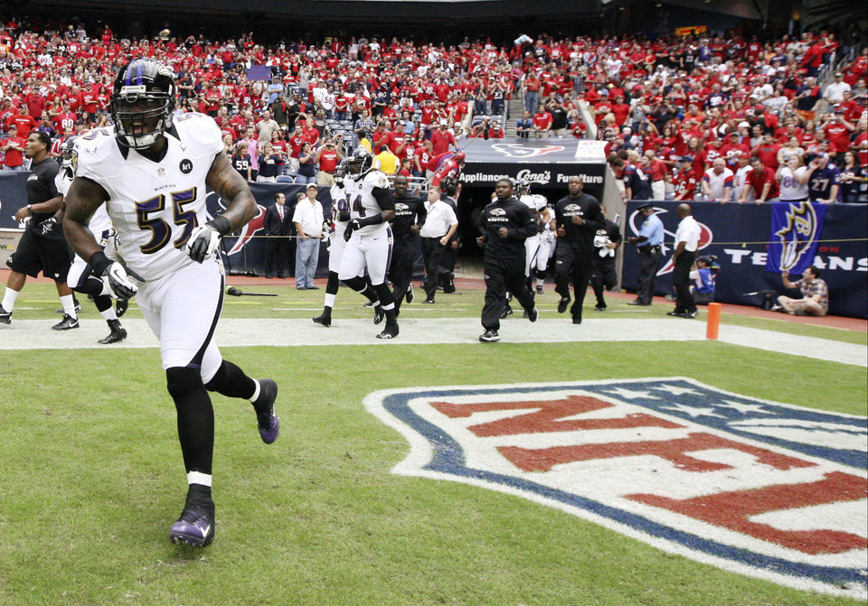Photo -   Baltimore Ravens linebacker Terrell Suggs (55) takes the field before an NFL football game against the Houston Texans, Sunday, Oct. 21, 2012, in Houston. The Texans won 43-13. (AP Photo/Patric Schneider)