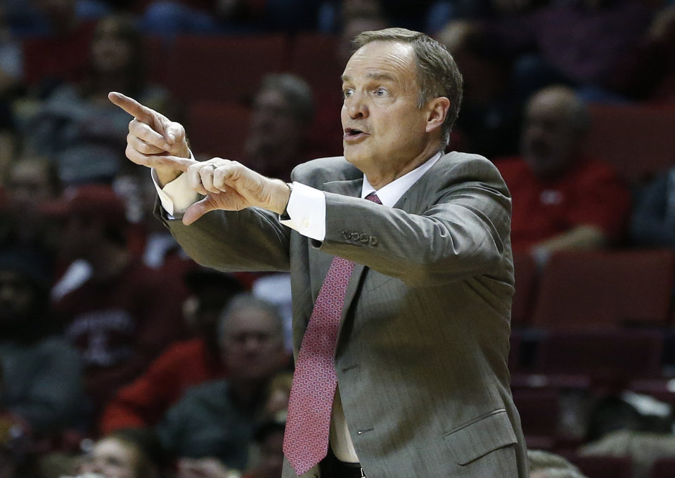 Photo - Oklahoma head coach Lon Kruger gestues in the second half of an NCAA college basketball game against Baylor in Norman, Okla., Saturday, Feb. 8, 2014. Oklahoma won 88-72. (AP Photo/Sue Ogrocki)
