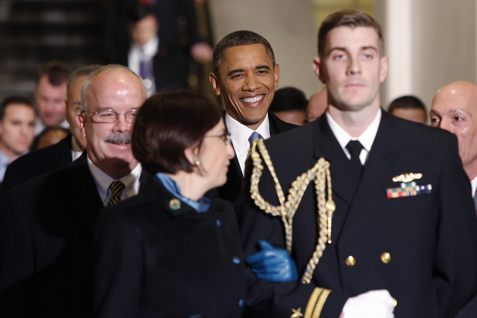 President Barack Obama smiles as he is escorted through the corridor to the West Front of the Capitol in Washington, Monday, Jan. 21, 2013, for his ceremonial swearing-in ceremony during the 57th Presidential Inauguration.(AP Photo/Jonathan Ernst, Pool)