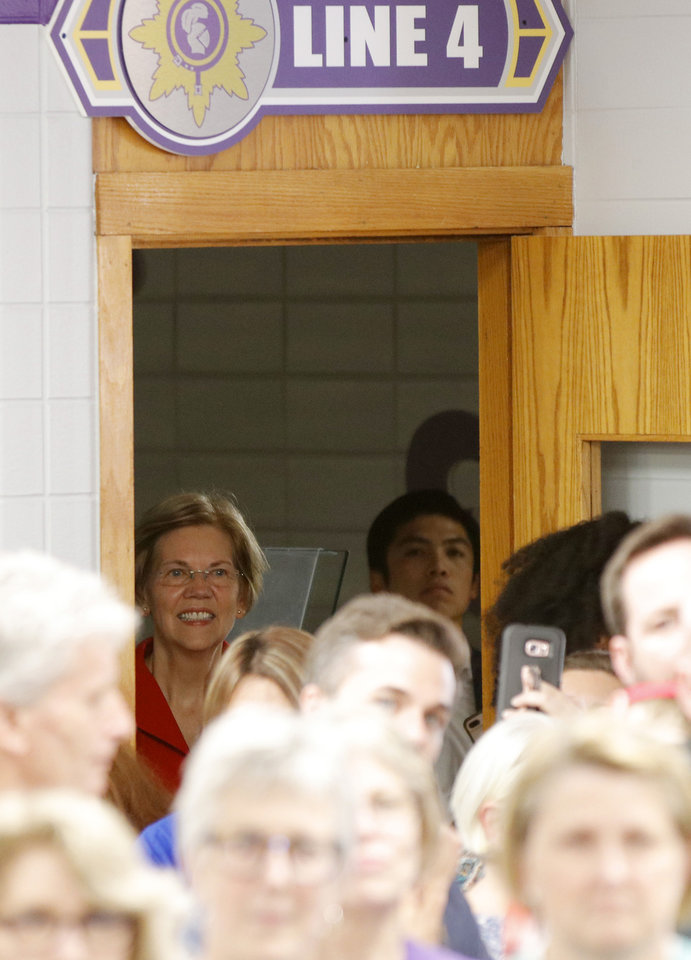Photo - U.S. Senator and NWC Alum, Class of '66 Elizabeth Warren, the main speaker, watches from the wings as she is introduced at the AFT education rally at Northwest Classen High School, Saturday, September, 22, 2018.  Photo by Doug Hoke, The Oklahoman