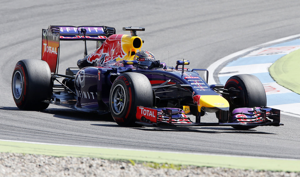 Photo - Red Bull driver Sebastian Vettel of Germany races during the third practise session of the German Formula One Grand Prix in Hockenheim, Germany, Saturday, July 19, 2014. The German Grand Prix will be held on Sunday.(AP Photo/Michael Probst)
