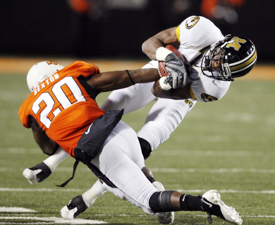 Photo - Andre Sexton (20) breaks up a pass intended for Danario Alexander (81) during the second half of the college football game between Oklahoma State University (OSU) and the University of Missouri (MU) at Boone Pickens Stadium in Stillwater, Okla. Saturday, Oct. 17, 2009.  Photo by Steve Sisney, The Oklahoman