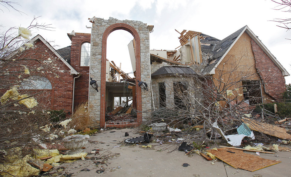 Photo - Damage to a home in the Oak Tree addition on Wednesday, Feb. 11, 2009, after a tornado hit the area on Tuesday in Edmond, Okla.  PHOTO BY CHRIS LANDSBERGER, THE OKLAHOMAN