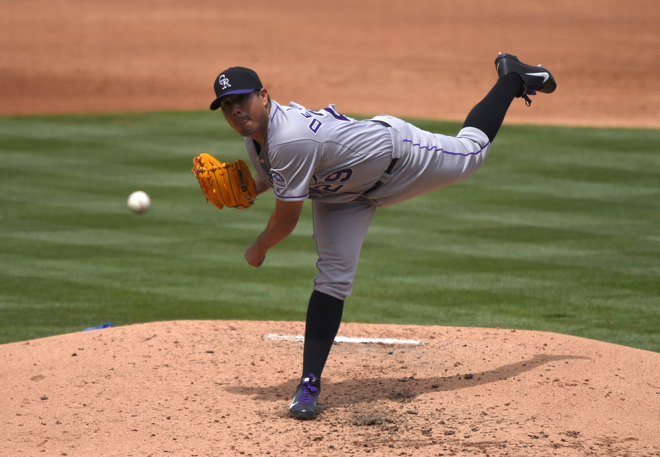 Photo - Colorado Rockies starting pitcher Jorge De La Rosa throws to the plate during the second inning of a baseball game against the Los Angeles Dodgers, Sunday, April 27, 2014, in Los Angeles. (AP Photo/Mark J. Terrill)