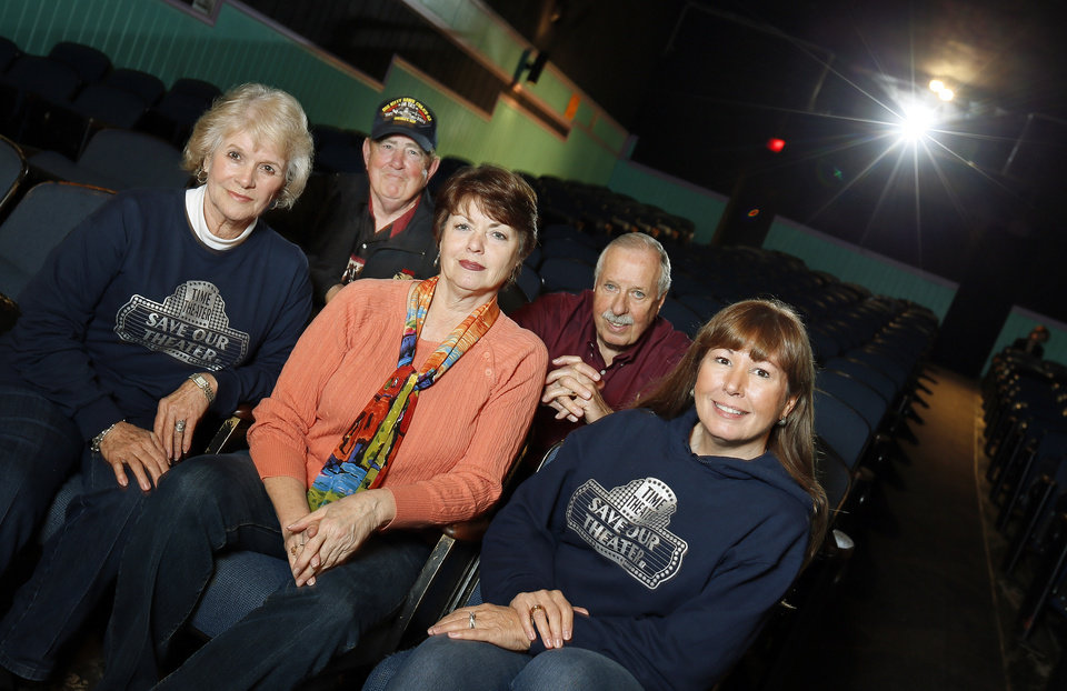 Front row, from left, Glenda Allen, Delores Roye, Mitzi Woodson, back row; Jim Aldridge and Jim Smith, photographed on Thursday, Feb. 7, 2013, are working with others in the community to keep the Time Theater open in Stigler, Okla. The community is raising the $100,000 needed to convert the theater to digital projection and keep it open. Jim Aldrige\'s wife\'s grandparents were the original owners of the theater. Jim Smith is the city manager of Stigler. Glenda Allen leads the Stigler High School alumni campaign for the