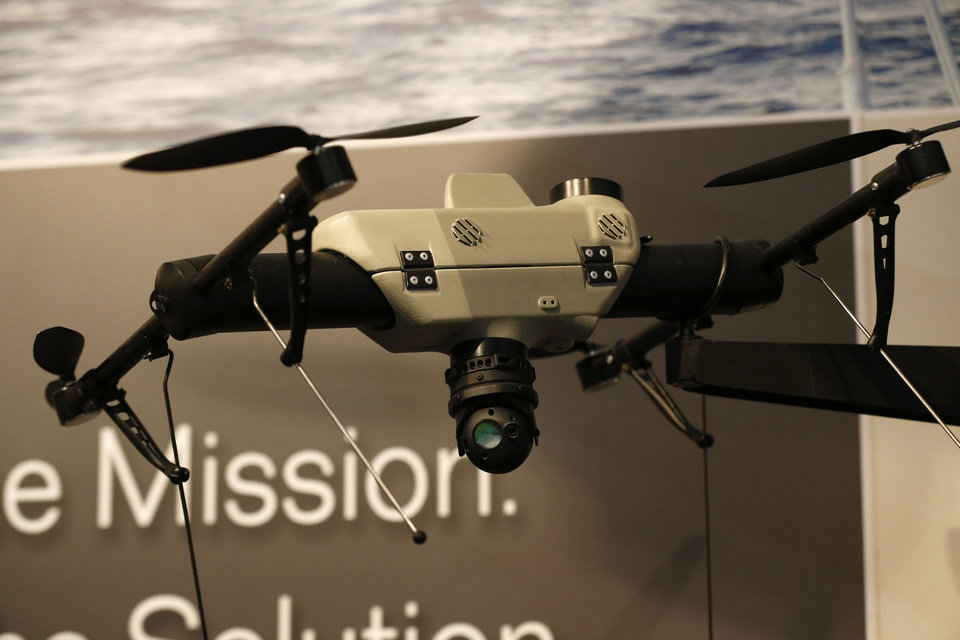 Photo -  An AeroVironment Shrike vertical take-off and landing small unmanned aircraft system is displayed at the AeroVironment stand during the Farnborough International Airshow on Tuesday. AP Photo   Sang Tan