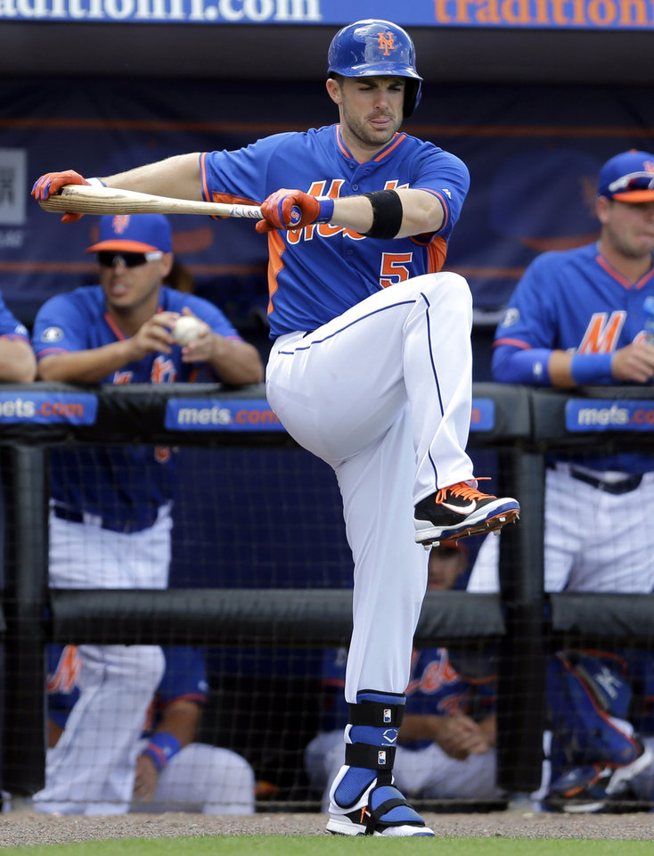Photo - New York Mets' David Wright stretches before batting during the fourth inning of an exhibition spring training baseball game against the St. Louis Cardinals, Friday, March 7, 2014, in Port St. Lucie, Fla. (AP Photo/Jeff Roberson)