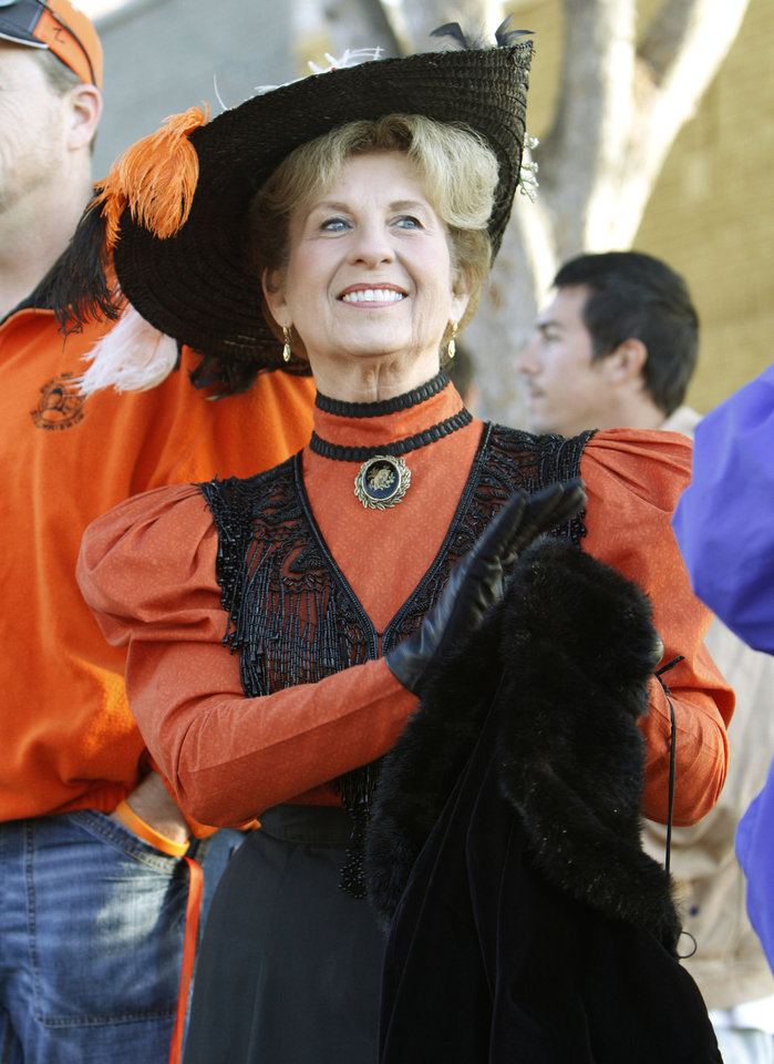 Photo - Linda Greenshields, with the Oklahoma Historical Society, dresses in period costume during the Oklahoma State Cowboy's homecoming parade in downtown Stillwater, OK, Saturday, Oct. 29, 2011. By Paul Hellstern, The Oklahoman