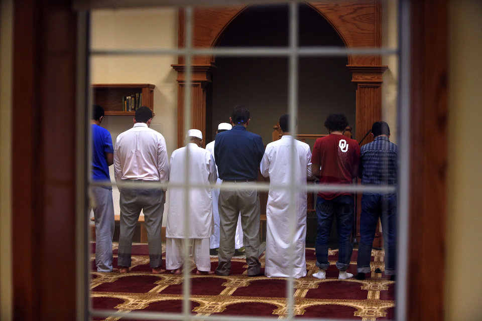 Photo - Men pray in a prayer room at the new mosque built by the Islamic Society of Norman at 420 E Lindsey in Norman.   SARAH PHIPPS - SARAH PHIPPS