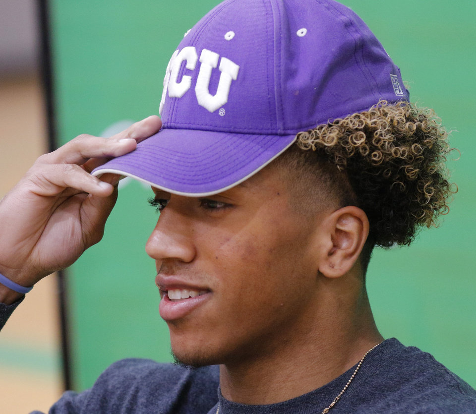 Photo - Dominic Richardson, McGuinness, commits to TCU during National Signing Day for high school football players, Wednesday, December 18, 2019. [Photo by Doug Hoke/The Oklahoman]