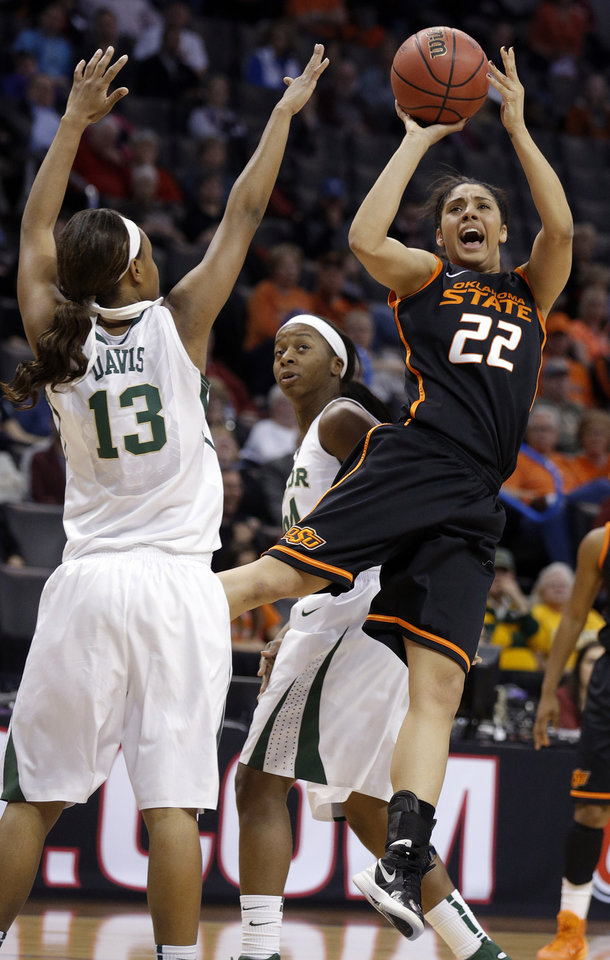Photo - Oklahoma State's Brittney Martin (22) shoots as Baylor's Nina Davis (13) defends during the Women's Big 12 basketball tournament game between Baylor and Oklahoma State at Chesapeake Energy Arena  in Oklahoma City, Okla., Sunday, March 9, 2014. Photo by Sarah Phipps, The Oklahoman