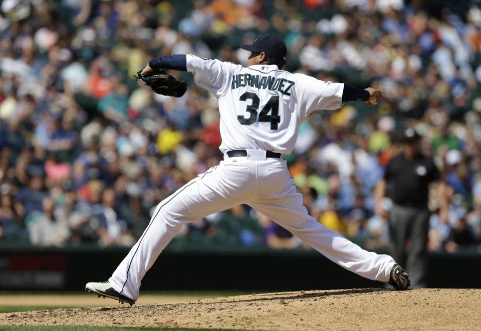 Photo - Seattle Mariners starting pitcher Felix Hernandez throws in the fifth inning of a baseball game against the Milwaukee Brewers, Sunday, Aug. 11, 2013, in Seattle. (AP Photo/Ted S. Warren)