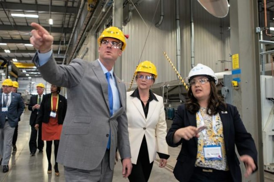 Photo -  Oklahoma Gov. Kevin Stitt and Maria Claudia Borras, president and CEO of Baker Hughes Oilfield Services, tour the center with Karen Lane, senior plant manager at the BHGE Motor Center of Excellence in Oklahoma City. [Provided by Baker Hughes]