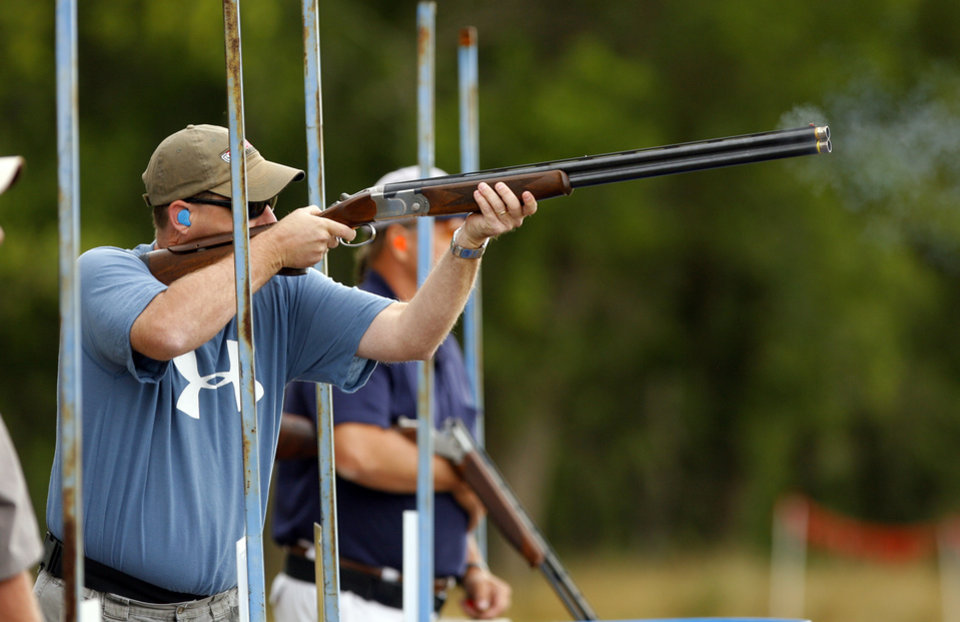 Photo - Tobin Partis, Edmond, fires on the practice range during the Oklahoma Sporting Clays State Championships being held at Quail Ridge Sporting Clays on Friday, June 1, 2012, in Oklahoma City, Okla.  Photo by Steve Sisney, The Oklahoman