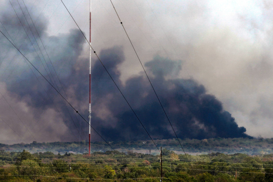 Photo - White, gray and black smoke dominate the horizon as a large wildfire burns out of control near NE 63 and Sooner Road in northeast Oklahoma County, Tuesday afternoon, Aug. 30, 2011,    Photo by Jim Beckel, The Oklahoman