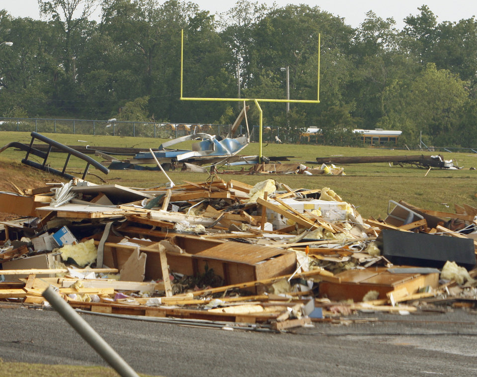Photo - The football stadium, buildings and bleachers were ravaged by the storm in Little Axe on Monday, May 10, 2010, in Norman, Okla.  Photo by Steve Sisney, The Oklahoman