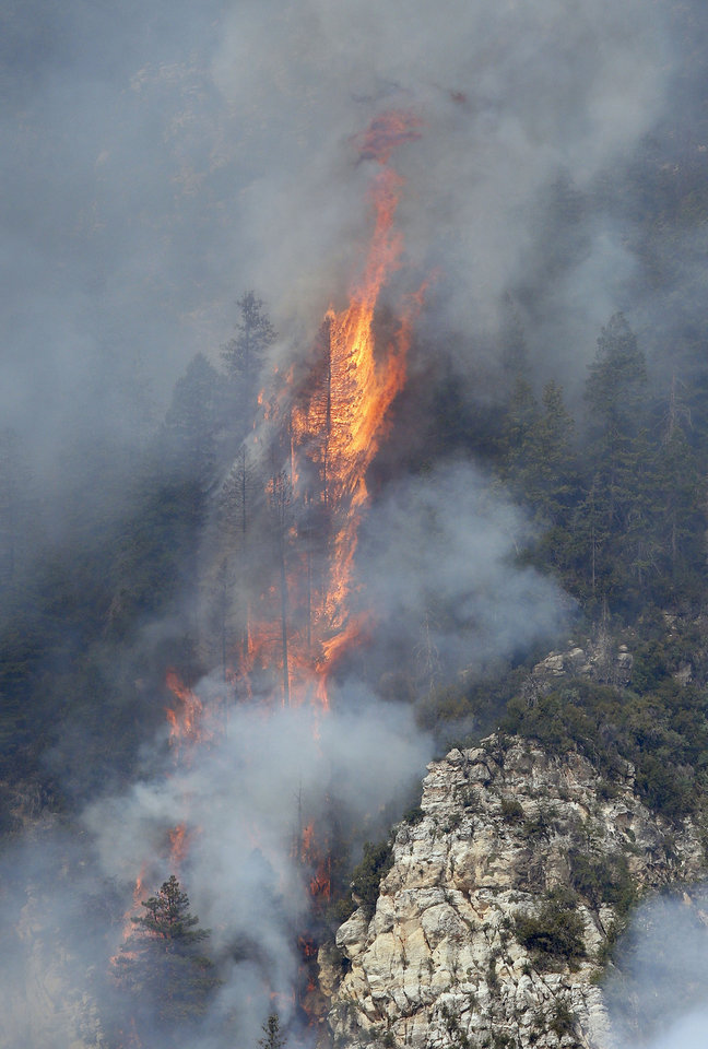 Photo - Flames from the Slide Fire burn up Oak Creek Canyon on Friday, May 23, 2014, near Flagstaff, Ariz.  The fire has burned approximately 7,500 acres and is five percent contained. (AP Photo/Ross D. Franklin)
