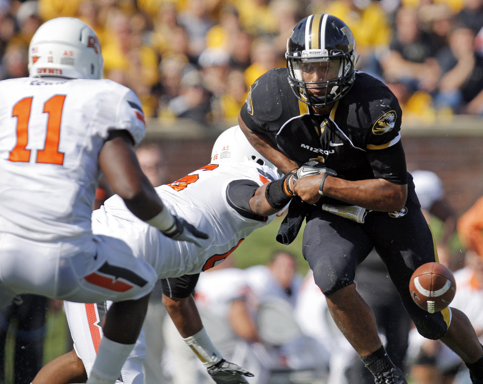 Missouri's James Franklin (1) loses the ball as Oklahoma State's Wilson Youman (86) forces a fumble next to Oklahoma State's Shaun Lewis (11) in the third quarter during a college football game between the Oklahoma State University Cowboys (OSU) and the University of Missouri Tigers (Mizzou) at Faurot Field in Columbia, Mo.,  OSU won, 45-24. Saturday, Oct. 22, 2011. Lewis recovered the fumble for OSU. Photo by Nate Billings, The Oklahoman
