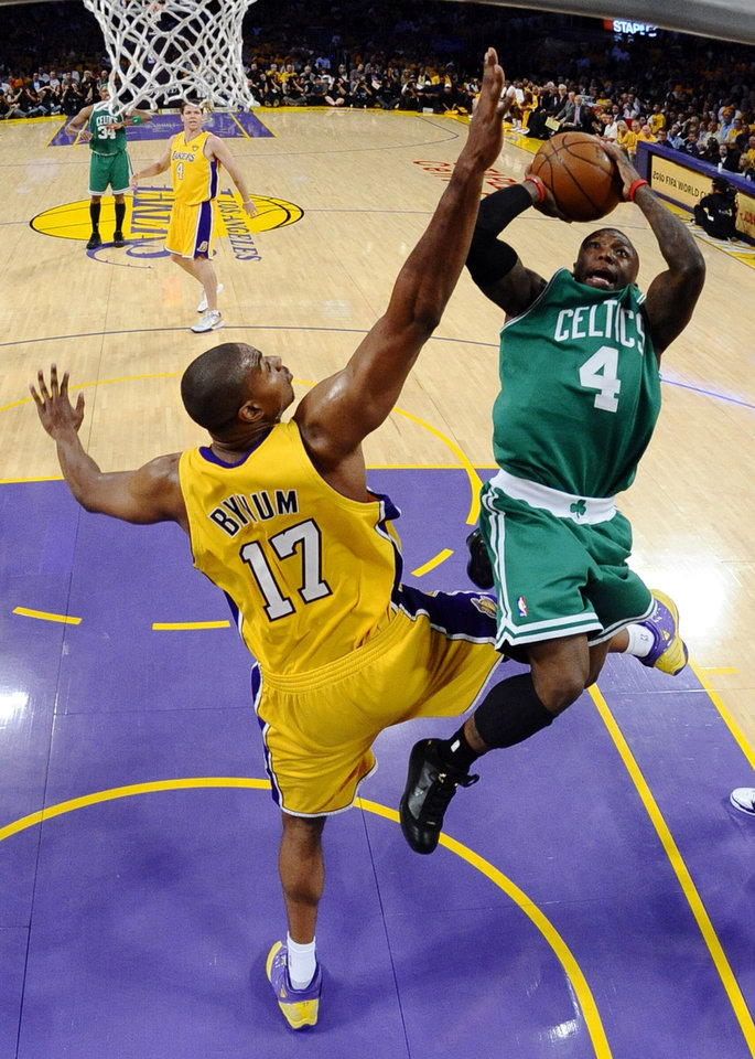 Boston Celtics guard Nate Robinson shoots over Los Angeles Lakers center Andrew Bynum during the first half of Game 1 of the NBA basketball finals Thursday, June 3, 2010, in Los Angeles. (AP Photo/Larry W. Smith, Pool)