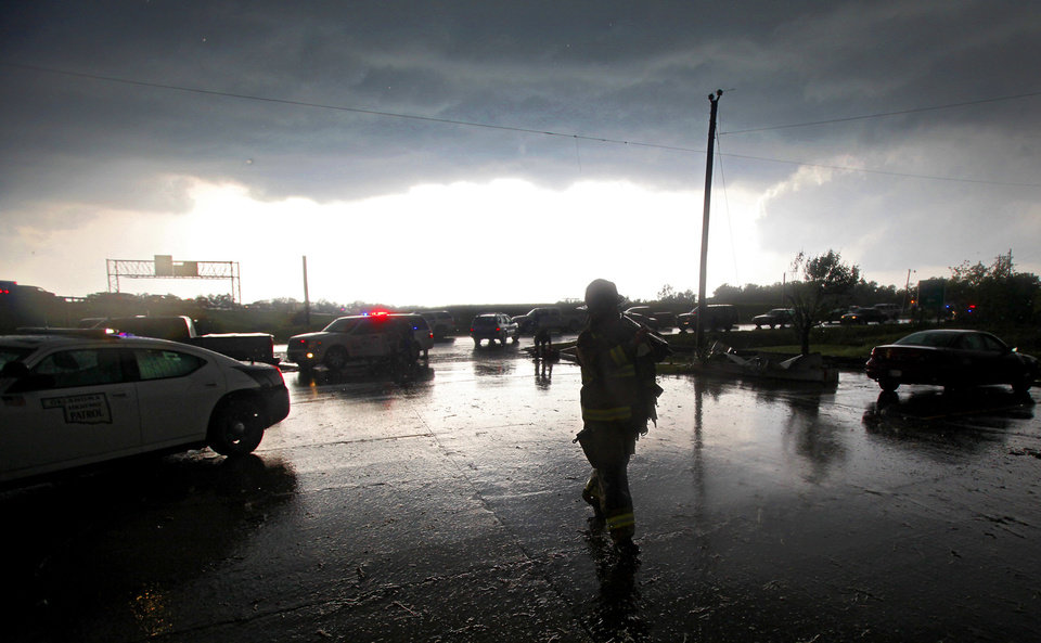An Oklahoma City firefighter arrives on the scene after a tornado damaged the area around I-40 and Choctaw Road on Monday, May 10, 2010, in Oklahoma City, Okla.  Photo by Chris Landsberger, The Oklahoman