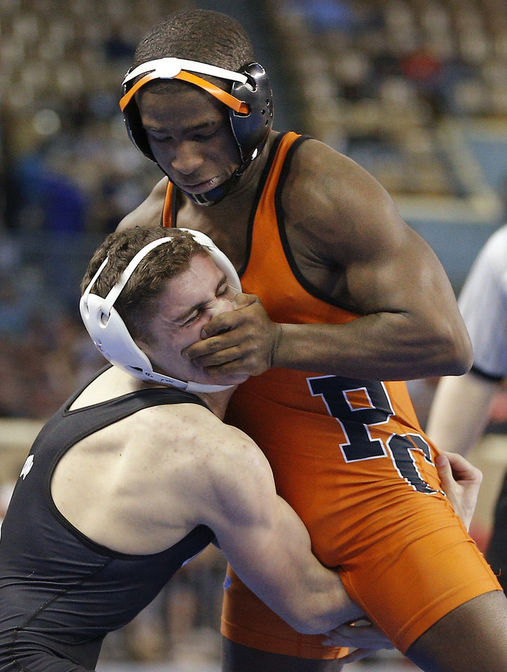 Photo - Putnam City's Zachary Moore, top, wrestles Shea Conley of Broken Arrow in a semifinal 138 pound match in the Class 6A state wrestling tournament at Jim Norick Arena at State Fair Park in Oklahoma City, Friday, Feb., 28, 2014. Photo by Bryan Terry, The Oklahoman
