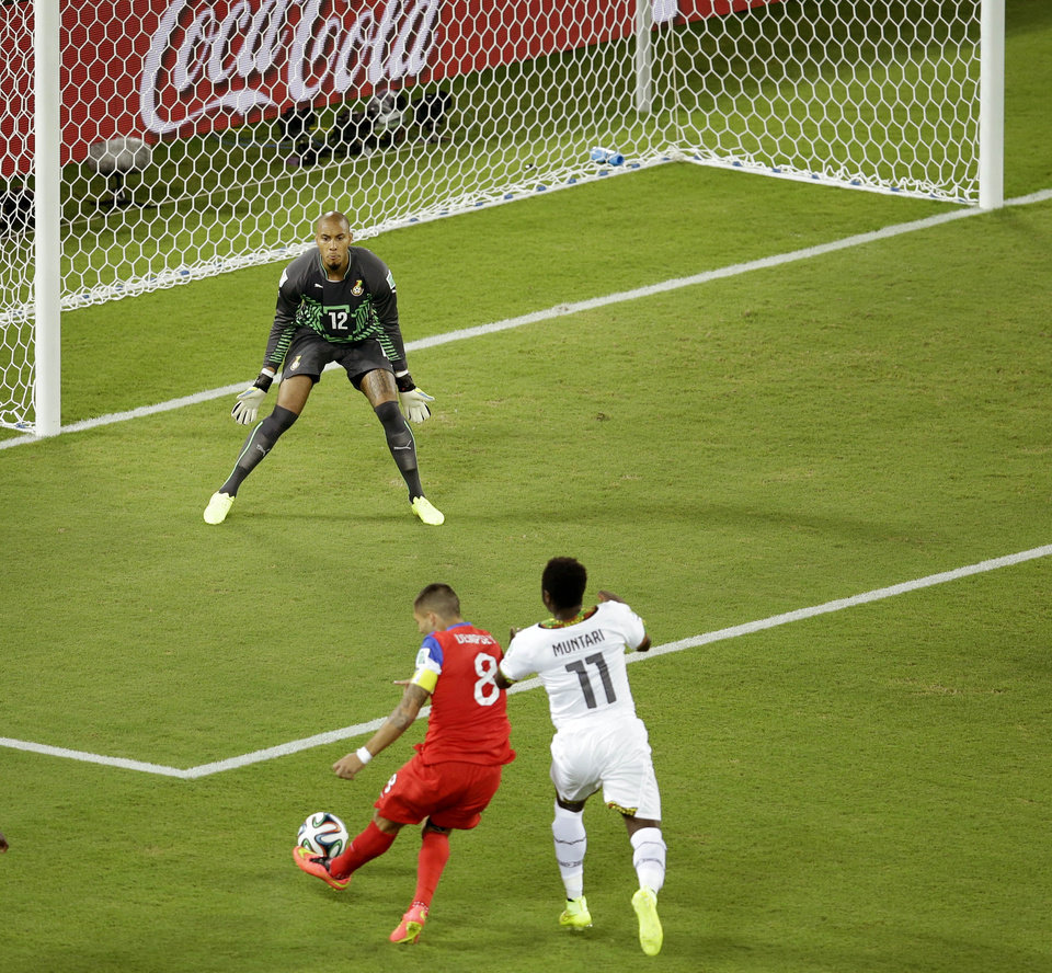 Photo - FILE - In this June 16, 2014 file photo, United States' Clint Dempsey, bottom left, scores the opening goal past Ghana's goalkeeper Adam Kwarasey, top, during the group G World Cup soccer match at the Arena das Dunas in Natal, Brazil. Dempsey scored his first goal of the tournament only 30 seconds into the match, the fifth fastest goal in World Cup history. (AP Photo/Hassan Ammar, File)