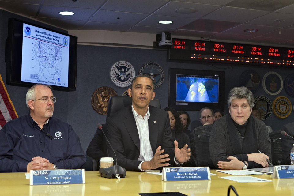 Photo -   President Barack Obama visits the Federal Emergency Management Agency (FEMA) for an update on the recovery from Hurricane Sandy that hit the northeast earlier this week, Saturday morning, Nov. 3, 2012, in Washington. He is flanked by FEMA chief Craig Fugate, left, and Homeland Security Secretary Janet Napolitano, right. (AP Photo/J. Scott Applewhite)