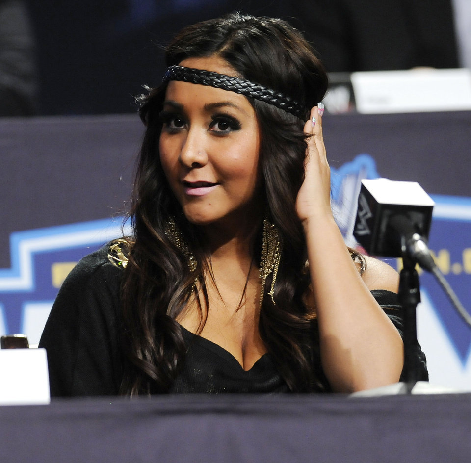 "FILE - In this March 30, 2011 file photo, reality television star Nicole ""Snooki"" Polizzi participates in a Wrestlemania XXVII news conference at the Hard Rock Cafe in New York. Polizzi and a fellow ""Jersey Shore"" cast member have been involved in a minor traffic accident in Italy. (AP Photo/Evan Agostini, File) ORG XMIT: NY135"
