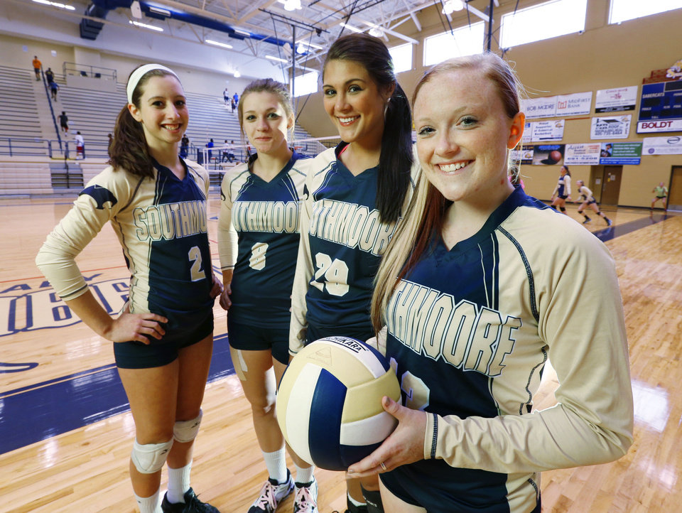 Photo - Southmoore senior volleyball players Amy Serowski, Brianna Ruby, Micayla Payne, and Carly Fuget pose on Wednesday, Oct. 16, 2013 in Moore, Okla.  Photo by Steve Sisney, The Oklahoman  STEVE SISNEY - THE OKLAHOMAN