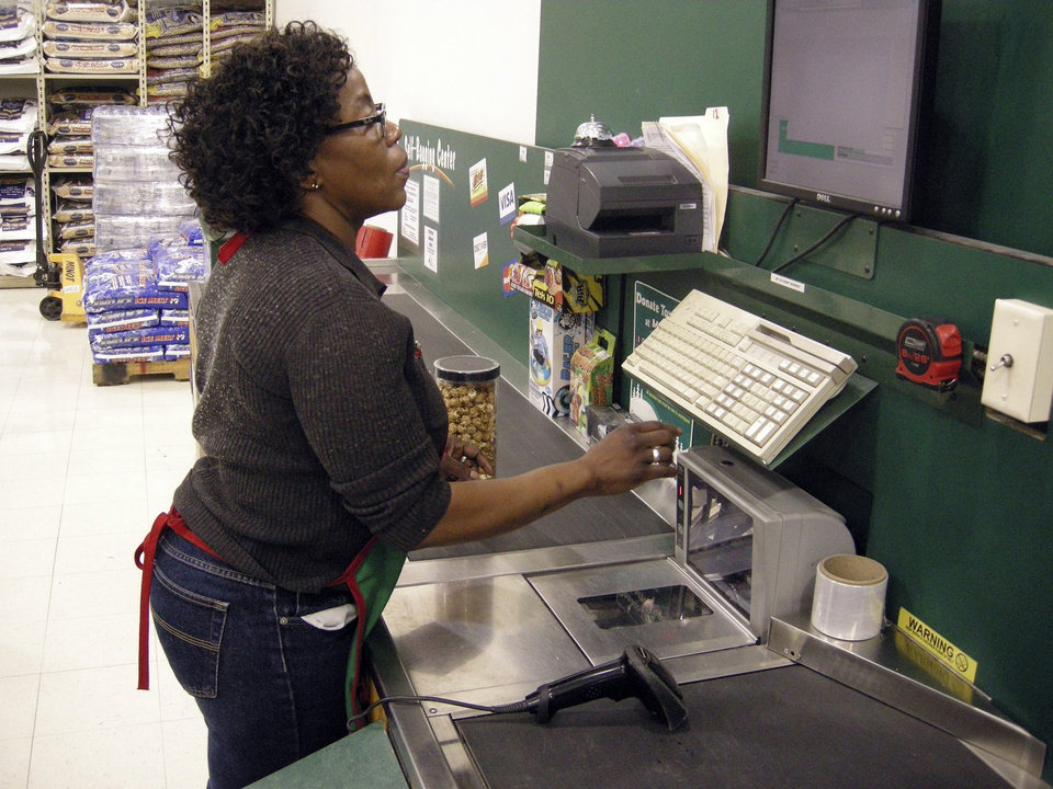 Esther Bull, who previously worked at the Richfield, Minn. Menards store, works at the company\'s Minot, N.D. location Thurdsay, Nov. 29, 2012. The home improvement retailer says it will hire workers from its home base in Wisconsin and fly them to North Dakota to staff a store in Minot, which is near the state\'s booming oil patch and has more jobs than takers. (AP Photo/The Minot Daily News, Jesse D. Watson)