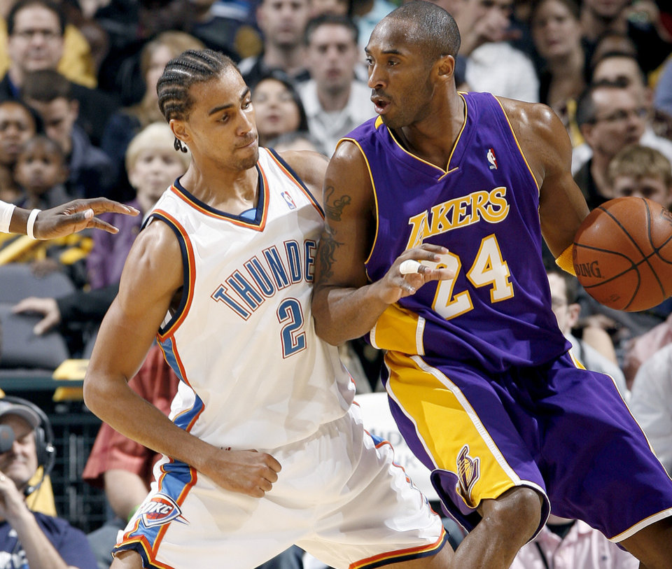 Photo - Oklahoma City's Thabo Sefolosha guards the Lakers' Kobe Bryant during the NBA basketball game between the Los Angeles Lakers and the Oklahoma City Thunder at the Ford Center,Tuesday, Feb. 24, 2009. [Bryan Terry/The Oklahoman Archives]