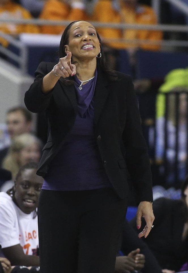 Photo - Auburn coach Terri Williams-Flournoy makes a point during the first half against Texas A&M in an NCAA college basketball game in the quarterfinals of the Southeastern Conference women's tournament, Friday, March 7, 2014, in Duluth, Ga. (AP Photo/Jason Getz)
