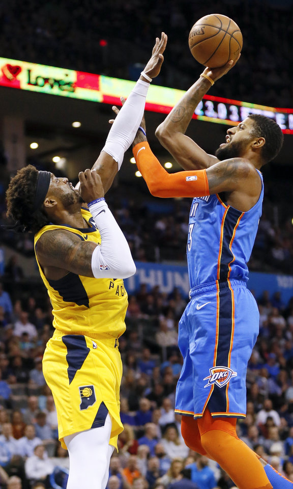 Photo - Oklahoma City's Paul George (13) shoots over Indiana's Wesley Matthews (23) during an NBA basketball game between the Indiana Pacers and the Oklahoma City Thunder at Chesapeake Energy Arena in Oklahoma City, Wednesday, March 27, 2019. Photo by Nate Billings, The Oklahoman